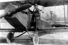 220px-Bessie_Coleman_and_her_plane_(1922)